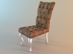 quilted upholstered chair with lacquered legs